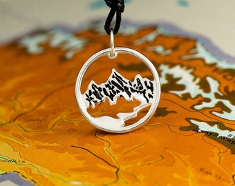 "Pendant ""Mountains"".   Mountaineering, rock climbing, backpackers and hikers charm"
