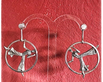 Earrings silver Acrobat circus inside the ring. Outstanding acrobats. Earrings silver acrobats and rings.