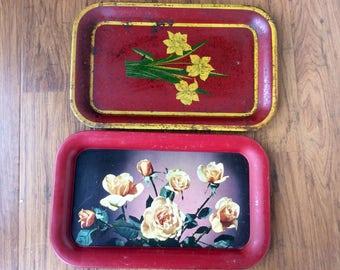 Two vintage metal floral trays