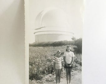 vintage black and white photo of two kids in front of an observatory dome