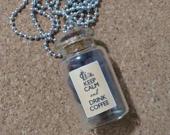 Glass bottle necklace.