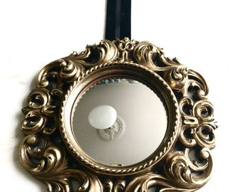 Fabulous butler mirror in gilded frame on cord.