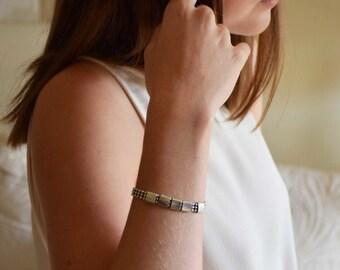 String and brass rings bracelet