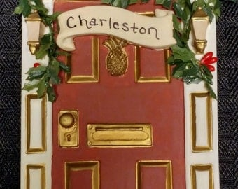 Vintage Rust-Colored Charleston Door Ornament with Holly and Pineapple Symbol