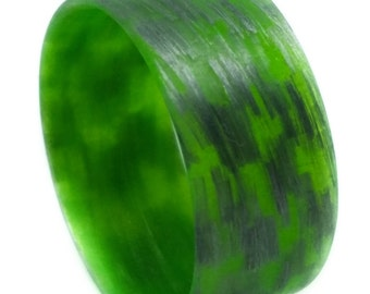 Texalium Silver Ring with green inside