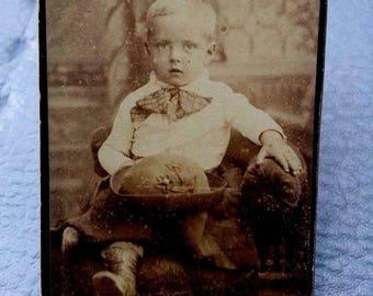 Antique sepia photograph of little child