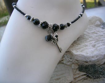 Black silver ankle bracelet.