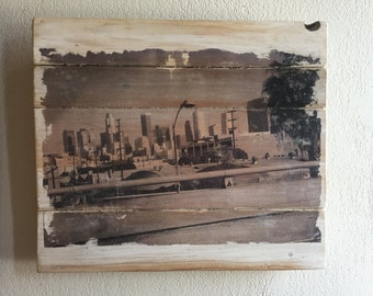 "Original Black and White photograph of Los Angeles transferred onto reclaimed wood slats. Wall hanging 16"" x 14"""
