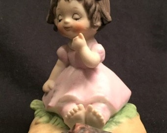"""Lefton China 2.5"""" little girl sitting by a campfire figurine"""