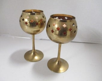 K Vintage set of 2 brass Candle holders with candles. used