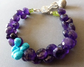 Pile On The Gems Bracelet - plump sparkly Amethyst onion briolettes, Sleeping Beauty Turquoise brios off-center, and lime peridots on silver