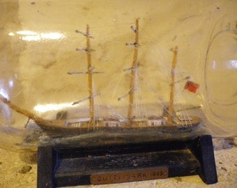 Antique model of the Cutty Sark in a bottle thought to be c1900, ship in a bottle, collectible ship in a bottle