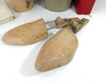 Wooden shoe stretchers, cobbler tools, wood shoe forms, 2 piece bendable shoemakers molds. French vintage decor, wooden shoe display.