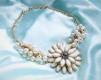 Statement necklace with pearls in cream white