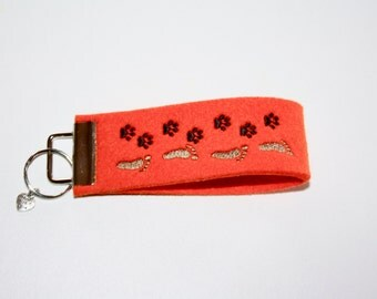 "Key ring orange brown embroidered ""Companion"""