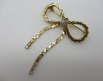 AVON Gold Tone Marquise Rhinestone Bow Brooch
