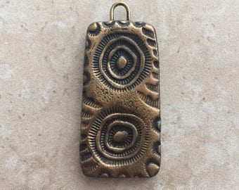Handmade rustic black and bronze abstract design faux stoneware polymer clay rectangular focal pendant