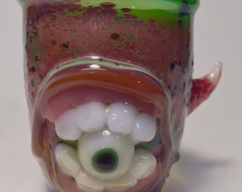 Green monster shot glass with teeth glow in the dark eye and horn 2 x 2 x 1.75 in