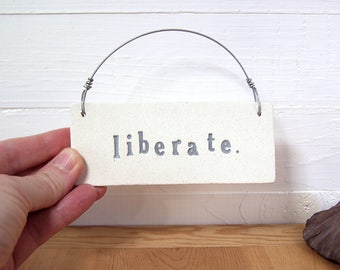 Liberate.   Ceramic Wall Sign.  Fired Clay Plaque.