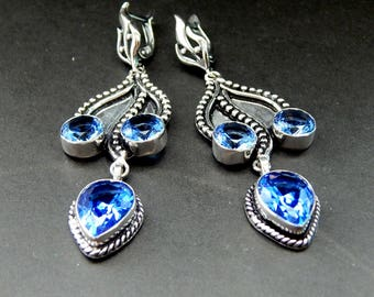 Silver earrings with Iolite.