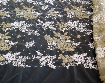 Gray tulle fabric embroiderd with floral embroidery and sequins