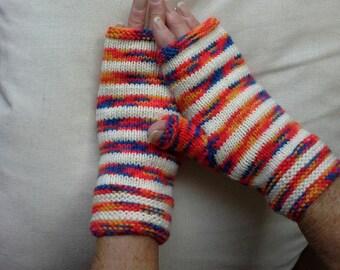Fingerless gloves.   Striped, yellows, oranges,  reds, white.