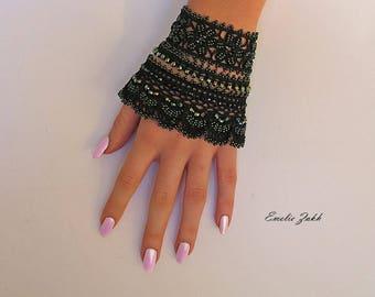 Black  beaded cuff - bracelet with beaded flowers and black crochet lace.Bracelet cuff crochet and beads