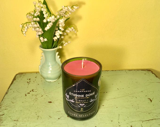 Etienne Doue Brut Champagne bottle with a Grapefruit Soy candle