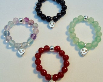 Beaded stretch ring with sterling silver scull charm