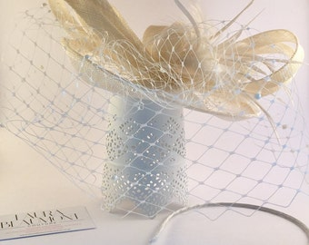 Ivory bridal fascinator with pearl russian veil