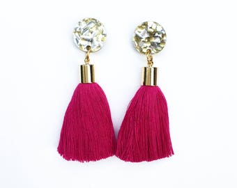 Fuchsia tassel earrings. Gold glitter acrylic laser cut earrings with fuchsia tassels