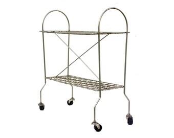 Art Deco metal shelf on wheels
