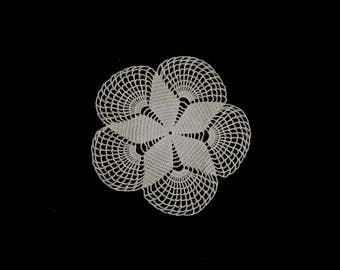 Vintage handmade small crocheted doily -- beige doily with a flower center and large fan-shaped scallops -- 7.5 inches / 19 cm