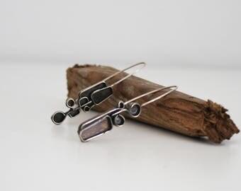 Earrings in silver and oxidized alpaca