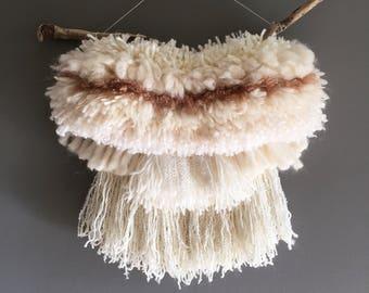 Cream weaving on Californian driftwood