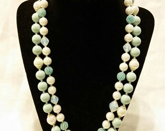 Blue and white pearlized double strand necklace.