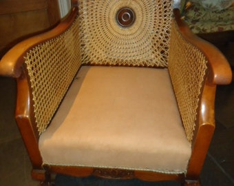 Early C20th carved and cane back bergere armchair with ball and claw feet