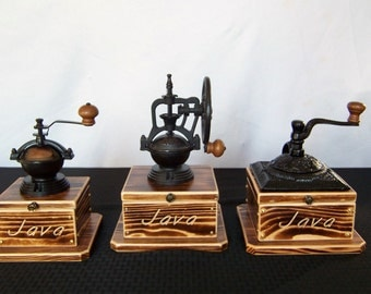 "Coffee Grinders 3 distinct Antique styles, ""burnt"" pine wood with Java engraving, cast iron body with a ceramick mechanism and a hinge top."