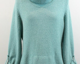 Light turquoise cotton blend turtleneck sweater with front hand pocket. By Style and Co.