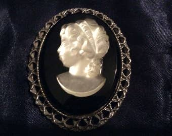 A Pretty Black Onyx/Crystal Mother of Pearl Cameo Brooch.