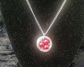 Bird's nest necklace, red eggs