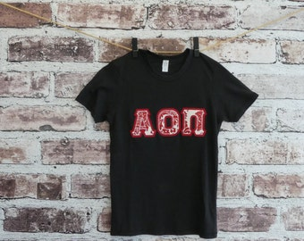Alpha Omicron Pi Small Black Alternative Apparel Short Sleeve Crew Neck Tee with Watermelon on White Damask Fabric on Red Twill