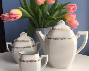A White and Gold Ceramic Tea or Coffee Set: Coffee Pot Teapot Sugar Bowl Milk Jug Creamer. Art Deco Style French Berry Limoges Porcelain.