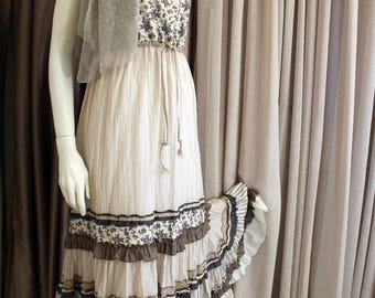 Romantic beige -gray color dress in boho chic style.