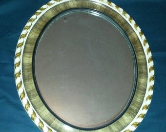 Vintage oval mirror with scalloped edges and leaf design, brown and cream in colour, original chain and wooden back