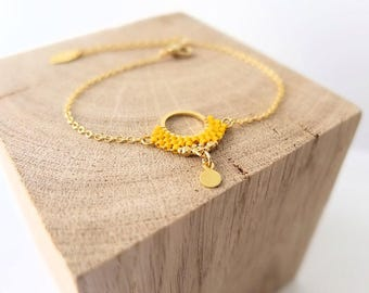 Miyuki stitchedbracelet, 24k gold over brass findings.
