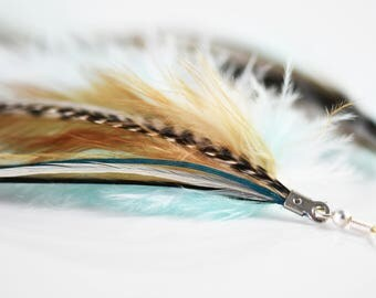 Statement feather earrings light blue with grizzly accent