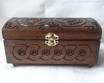 Wooden jewelry box. Wooden box carved