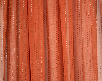 Coral orange semi-sheer fine polyester chiffon fabric with gold glitter stripes