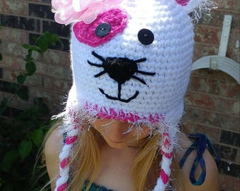 Crochet puppy dog hat with flower